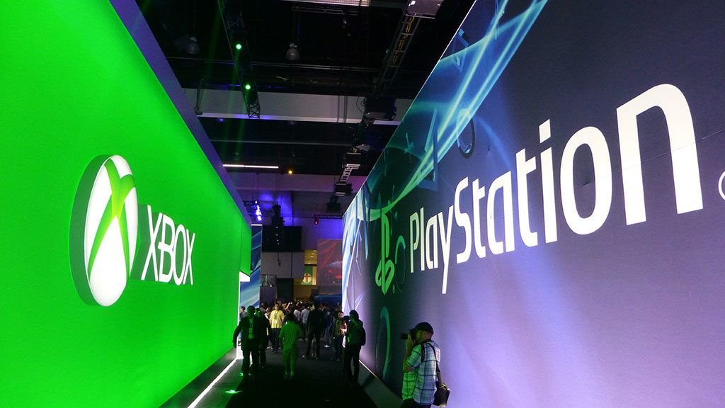 The PlayStation and Xbox booths at E3 2013
